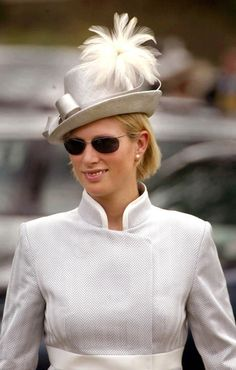 Zara Phillips, daughter of Princess Anne and the Queen's granddaughter arrives for Ladies Day at Royal Ascot in a grey straw hat with white feathers