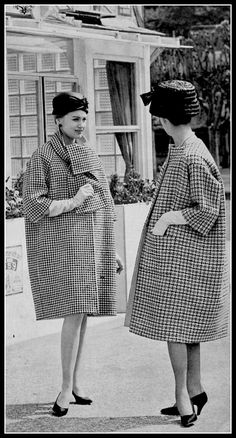 Houndstooth coat with scarf-collar by Givenchy, collarless checked coat by Balenciaga, photo by Georges Saad in front of La Tête Noir, restaurant in Paris, 1959