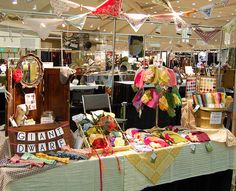 14 Craft Show Display Do's - look at the bandanas - could use as pennants across front of table for color/decor ideas for farmers market, flea market and craft show displays