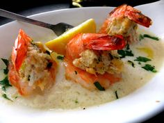 Baked shrimp generously stuffed with a delicious blue crab filling all sitting pretty in a champagne cream sauce, every bite is decadent! Perfect for a big party or just dinner for two.