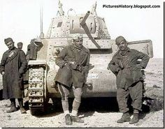 Italian soldiers with their tank in North Africa