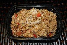 Cooked basmati rice/jasmine rice mixed with shredded chicken, red pepper, fish sauce and other ingredients
