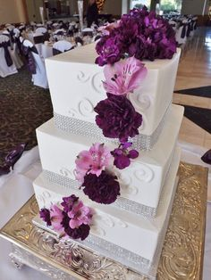 Purple white and silver wedding cake. Rhinestone wedding cake with Fresh Flowers. Square wedding cake  Polish Bakery & Hand-Crafted Cake Creations in Livonia, MI ::: GM Paris Bakery