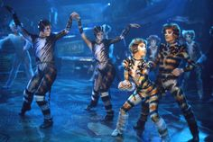 The cats at the jellicle ball hd from cats the musical the film coricopat and tantomile regal and mysterious jellicle cats are white and black stopboris Image collections