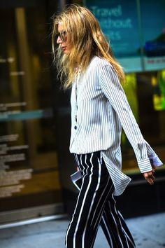 Sarah Rutson is known for her incredibly cool style and this look is no exception. The Vice President of Global Buying for Net-a-Porter was recently spotted in a stripe-on-stripe look that we can't wait to try for fall. The good news is that it's actually pretty easy to pull it off. All you need is a striped button-down shirt which you can keep the sleeves unrolled and unbuttoned, and a pair of contrasting pants with thicker stripes.