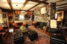 eclectic living room and kitchen with fireplace dividing rooms