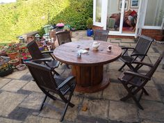 Up-cycled cable spool outdoor dining table. Challenge 1 Push up pewley hill. Challenge 2 Reduce height for correct dining ergonomics Challenge 3 Sand sand sand Challenge 4 Put it all back together …