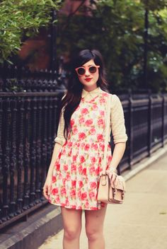 love this layering! button up shirt under floral dress.