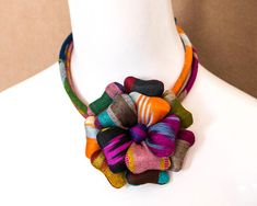 Ikat Textile Flower Brooch Pin Pendant Necklace by AiKijimaStore Textile Jewelry, Fabric Jewelry, Beaded Jewelry, Handmade Jewelry, Fabric Necklace, Diy Necklace, Pendant Necklace, African Accessories, African Jewelry
