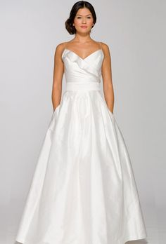 A defined waistline helps shrink your middle and boost your curves.Silk ruffled surplice neckline wedding dress, $878,Aria via @stylelist