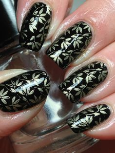 """""""Stamped using Barry M Foil Effects 320 Gold using an image from FUN 5"""" over a black creme polish."""
