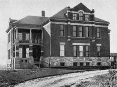 The building above, known as Cottage C, was one of the earliest buildings at the home. It was constructed in the late 1800s. Inset, is a la...