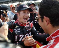 IndyCar driver Ryan Briscoe, left, of Australia, celebrates winning the pole with teammate Helio Castroneves, of Brazil, on the first day of qualifications for the Indianapolis 500 auto race at the Indianapolis Motor Speedway in Indianapolis, Saturday, May 19, 2012. (AP Photo/Tom Strattman) #Indycar