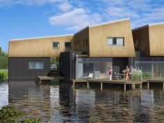 a luxury residential complex in rotterdam is built almost entirely on water, making the best use of the local landscape. Water Architecture, Residential Complex, Mansions, Luxury, House Styles, Building, Outdoor Decor, Small Houses, Rotterdam