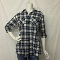 Plaid button down shirt with knit back. Made in USA of imported fabric Woven: 98% Cotton/ 2% Polyurethane Knit 95% Rayon/ 5% Spandex Handwash cold separately, do not bleach Cool iron if needed Pictured with jeans that can be found by clicking here.