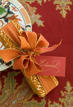 """Love this little gift on """"Edward's"""" plate, but also love the orange, red, and green color scheme - esp. for a Thanksgiving dinner"""