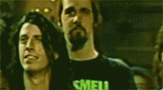 Dave Grohl and Krist Novoselic sharing a kiss.