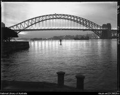 Evening with lights, Bridge [Sydney Harbour Bridge, Sydney] between 1910 and 1962  by Frank Hurley, Australian photographer