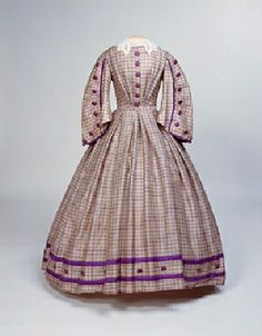 Dress: ca. 1860-1862, silk/apalca mix, checkered and trimmed with silk ribbon, covered buttons.