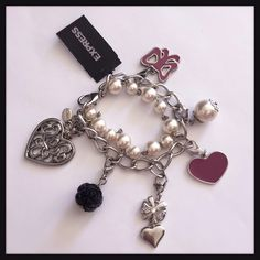 """NEW EXPRESS Pearl and Charm Two Strand Bracelet *Brand New with Tag* EXPRESS Pearl and Charm Two Strand Bracelet - Shiny silver colored metal chain with 6 removable charms attached to a pearl strand bracelet. Lobster clasp. Measures approx. 6"""" long with 1 1/2"""" extender. Express Jewelry Bracelets"""