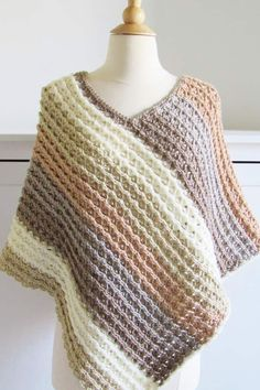 This free crochet poncho pattern for women comes in sizes small to plus sizes. Made from simple rectangle shapes, this poncho tutorial is quick and easy enough for beginners. # crochet ponchos for women Pattern for Crochet Poncho-Textured- Crochet Dreamz All Free Crochet, Easy Crochet Patterns, Crochet Stitches, Knit Crochet, Caron Cakes Patterns, Scarf Patterns, Crochet Ideas, Crochet Vests, Crochet Wraps