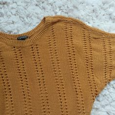 Crochet blouse Very versatile crochet blouse. Loose, short sleeves and a beautiful mustard color. Great with skinny jeans or pants. 77% cotton, 23% nylon. Worn only a couple of times. It's in perfect condition. Express Tops Blouses