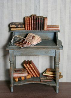 Vintage desk and books for a mini library. I love this!