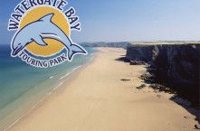Watergate Bay beach & logo, Watergate Bay Touring Park
