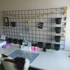 I've used plastic garden mesh (for fencing) with small plastic baskets and bulldog clips. Small Plastic Baskets, Garden Mesh, Small Office, Desk Organization, Fencing, Ikea, Stars, Instagram Posts, Room