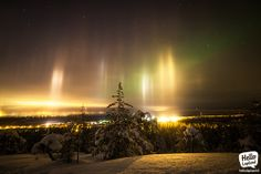 Light Beams & Auroras. Expectation were high 28.1.2014 when powerful Auroras should have appeared, but they turned out to be weak and obscured with clouds. The light beams, however, shined very bright as the temperature dropped below -17°C. Taken in Rovaniemi, Lapland, Finland.
