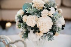 Neutral wintry floral arrangement | Chic Minnesota Winter Romance Engagement Session Featuring A Hot Chocolate Station | Photograph by Nicole Spangler Photography  http://storyboardwedding.com/chic-minnesota-winter-romance-engagement-session/
