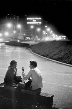 """Night in Havana. On the neon light at the background can be read : """"Patria o muerte"""" (homeland or death). Marc Riboud, National Lottery, Moving To Paris, Street Photographers, Magnum Photos, Homeland, Havana, The Neighbourhood, Cuba Stock"""