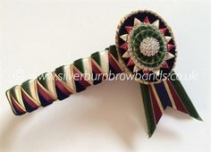 Antique green velvet, midnight velvet, cream satin, wine satin and gold lame sharkstooth shown detailed with oval rosettes, crystal rings and pictured with angled swallowtail flags www.silverburnbrowbands.co.uk Velvet Cream, Green Velvet, Gold Lame, Rosettes, Brow, Tack, Flags, Bands, Weaving