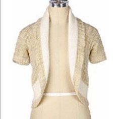 """ANTHROPOLOGIE """"Sleeping on Snow"""" Utopia Shrug Angora/wool blend. Oatmeal, ivory with golden glitter threads. Some open weave spots as seen on pic. Hans wash Anthropologie Sweaters Shrugs & Ponchos"""