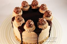 Ferrero Rocher Truffle Cake is as decadent as the name implies. Made with hazelnut sponge cake, truffle ganache filling and nutella buttercream. Cake Truffles, Cupcakes, Cupcake Cakes, Mini Cakes, Cakes To Make, Köstliche Desserts, Delicious Desserts, Dessert Recipes, Cake Frosting Recipe