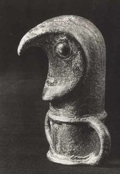 Bronze figure from Glasbacka in Halland, Sweden. The figure probably wears a mask with a hooked bird's beak. Late Bronze Age.
