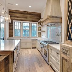 """""""Cabinets are painted and we are just finishing painting details and hanging sconces. #70seagrovevillage #30a #kitchen"""""""