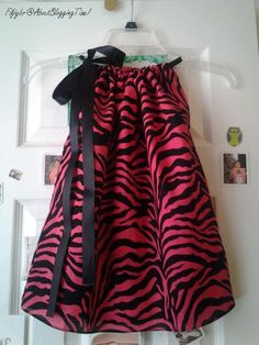 not a fan of these type of dresses for kids- but with the right fabric and ribbon its super cute!!!