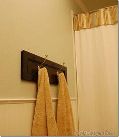 DIY Towel Rack ~ turn a cabinet door into a bathroom towel rack