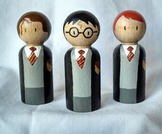 Harry Potter Gryffindor peg doll play set / collectible / cake toppers.  Check out this Etsy listing at https://www.etsy.com/listing/180837799/harry-potter-wizards-in-training-peg