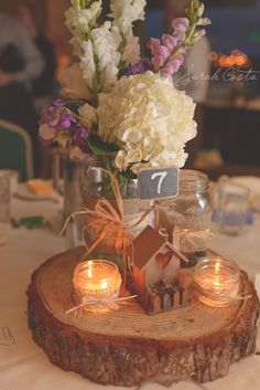 Cute centerpiece there is also a really cute wedding cake table set up on website, with cupcake holder made out of logs...very rustic