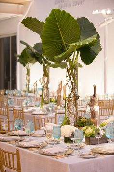 The simple beauty of tablescapes of giant leaves and natural colors - the blue glasses are the perfect touch!