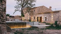 A Garden of Carved Stone by MESURA Architects in Peratallada, Spain