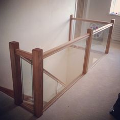 Oak contemporary square range with glass panels. Fitted with specialist groove in handrail and baserail to accommodate glass.