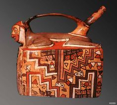 NAZCA  Peru clay. paint. Nazca bridge spout vessel in the form of a painted house with figure lying on roof.