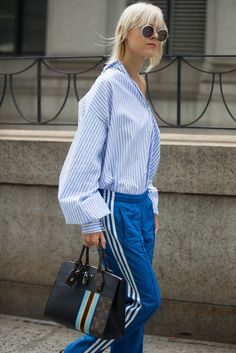 The Coziest Trend We've Ever Seen Just Hit the Streets at Fashion Week: The last time we wore Adidas track pants we were throwing them over gym shorts and pairing them with cleats for soccer practice  #StreetStyle