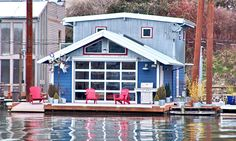 Hate the train-conducter-blue. Love the idea of the overhead door opening to bring outside in. Living On A Boat, Tiny Living, Living Spaces, Houseboat Living, Floating House, Waterfront Property, Pool Houses, Cottage Homes, Building A House