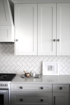 Subway tiles take on a fresh look when they're laid in a herringbone pattern that runs diagonally. Herringbone Subway Tile