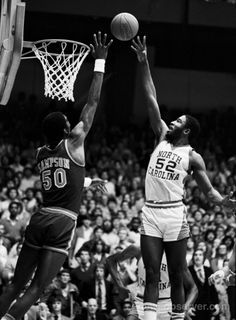 """""""UNC's James Worthy goes to the basket over Virginia's Ralph Sampson during a classic ACC battle in Chapel Hill in 1982."""""""