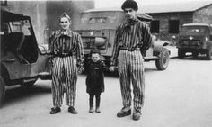 """Child survivor Joseph Schleifstein (center) poses with two young men wearing concentration camp uniforms in Buchenwald. The original caption reads """"The little boy, was four years old, had been in Buchenwald 3 years -- a political prisoner. World History, World War Ii, Jewish History, Dio, Boys Who, The Guardian, Mystery, The Past, Survival"""